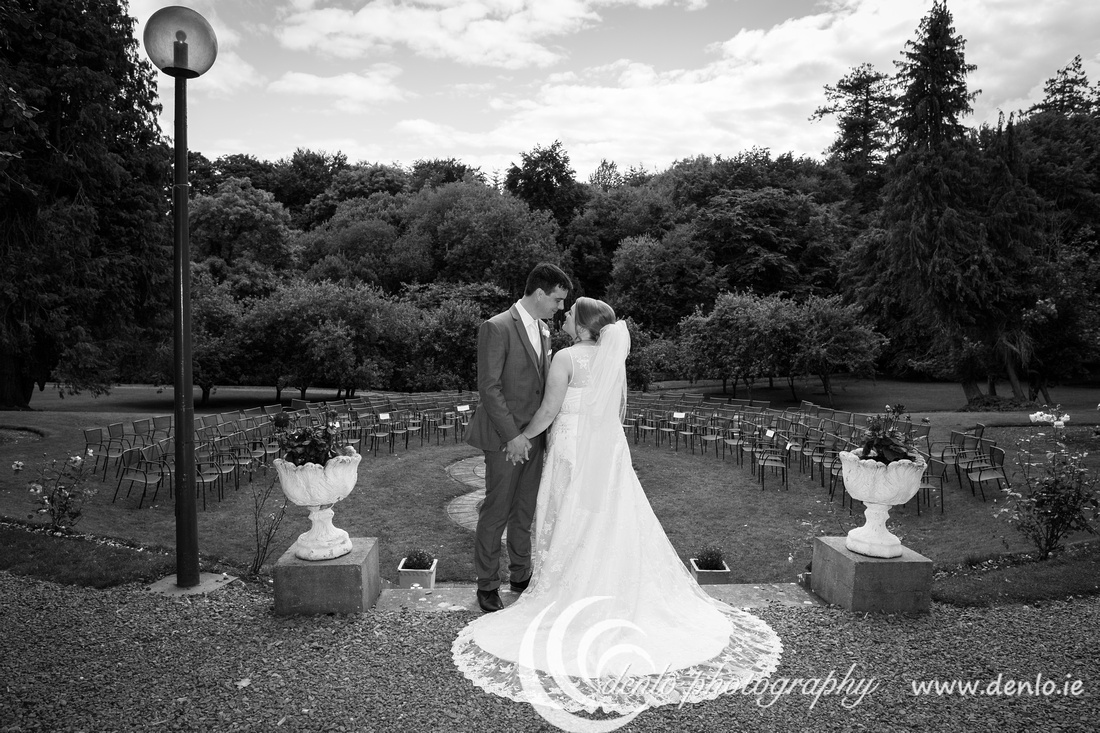 Bride and groom in the secret garden at Boyne Hill House