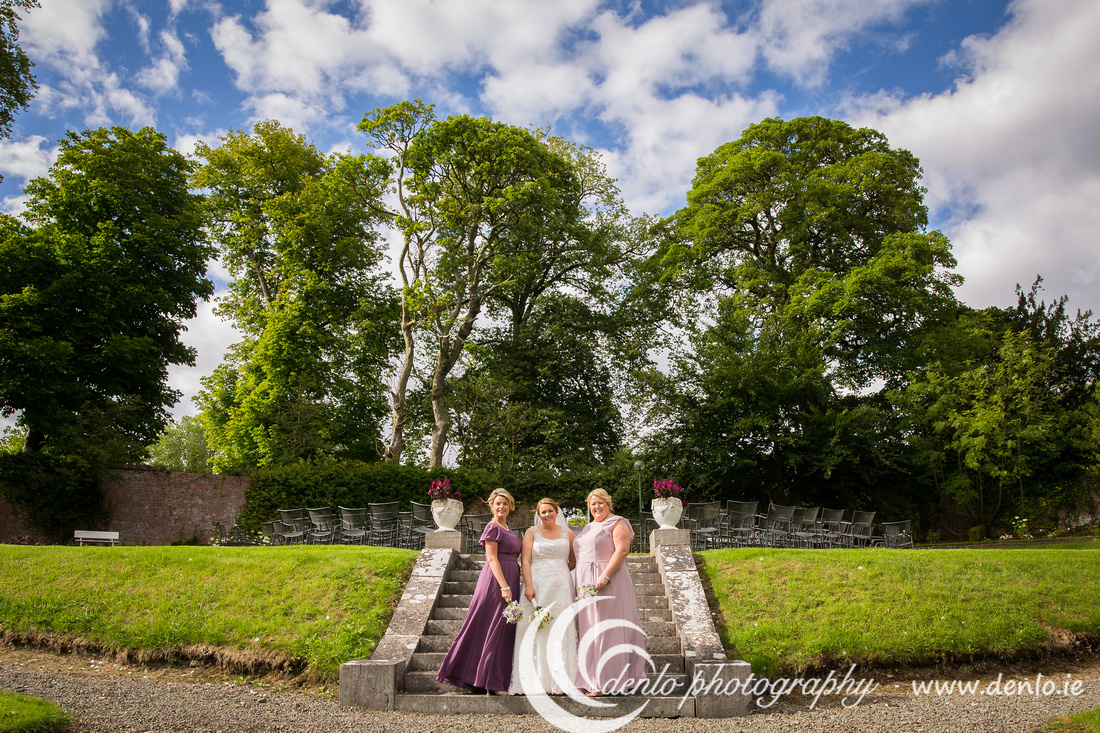 Bride and bridesmaids in the secret garden at Boyne Hill House