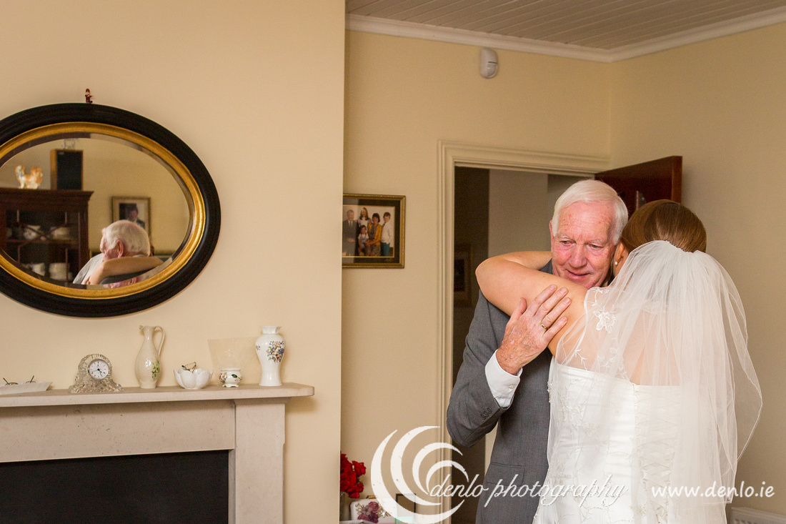 Father of the Bride sees his daughter in her dress for the first time.