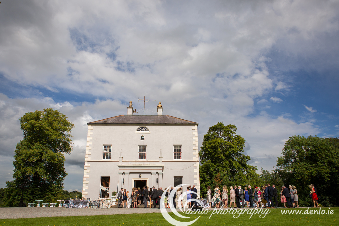 Greeting the bride and groom at Boyne Hill House